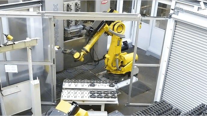 Steigern Sie die Fertigungsproduktivität durch automatisiertes Be- und Entladen von Teilen mit Ihrem flexiblen Fertigungssystem (FMS).